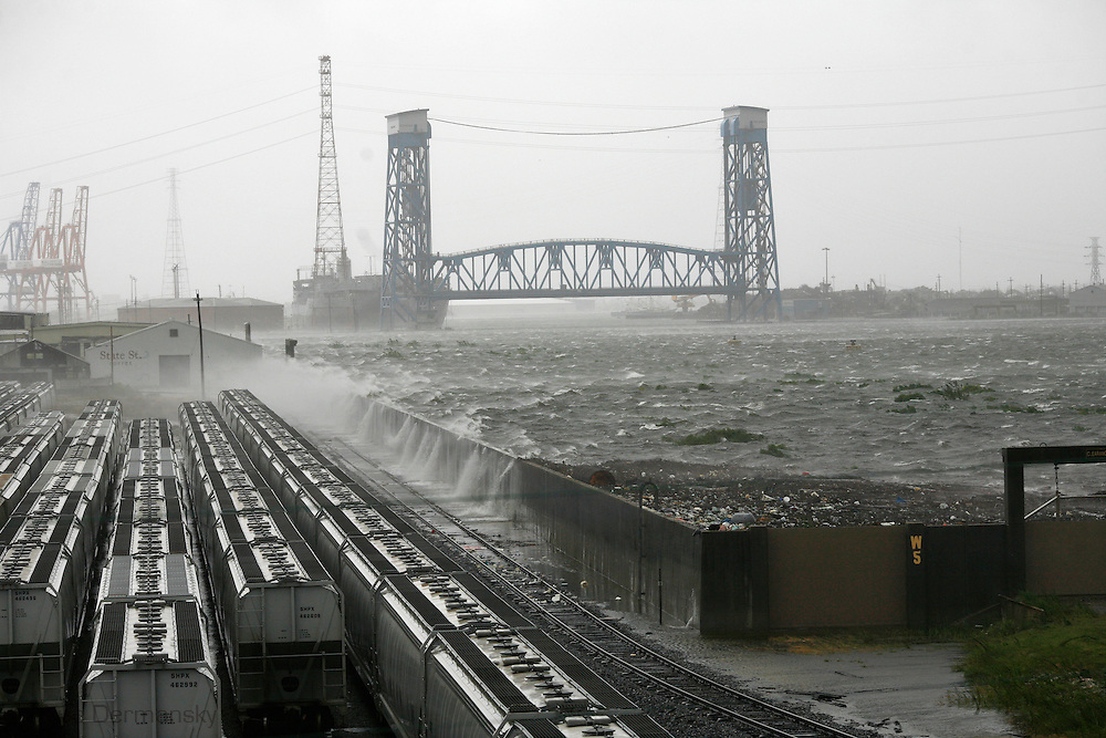White cresting waves crashing over the levy top. Shot while Gustav was hitting Louisiana