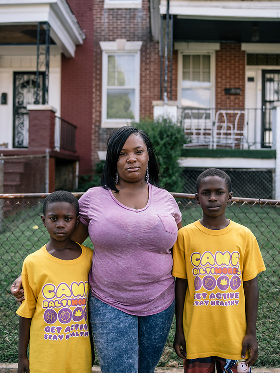 Amber Washington with her sons Isaiah Latham, 8, and Elijah, 10, live on the same block Odell lived on.