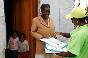 Net recipient - Ester Neliwa receives net from Malaria Agent Maria Kambala..Malaria Agents with Nets for Life distributing mosquito nets in the New Location in Tsumeb, Northern Namibia. November 16th 2010. .Picture by Zute Lightfoot www.lightfootphoto.com