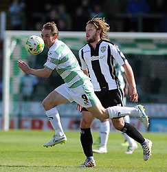 Yeovil Town's James Hayter is tackled by Alan Smith of Notts County - Photo mandatory by-line: Harry Trump/JMP - Mobile: 07966 386802 - 11/04/15 - SPORT - FOOTBALL - Sky Bet League One - Yeovil Town v Notts County - Huish Park, Yeovil, England.