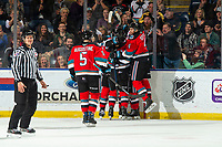 KELOWNA, BC - NOVEMBER 16:  Cayde Augustine #5, Devin Steffler #4, Liam Kindree #26, Dillon Hamaliuk #22 and Michael Farren #16 of the Kelowna Rockets celebrate a first period goal against the Kamloops Blazers at Prospera Place on November 16, 2019 in Kelowna, Canada. (Photo by Marissa Baecker/Shoot the Breeze)