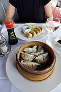 """Vienna, Austria. Steamed and fried Gyoza (""""Pot Stickers"""") at Kiang restaurant."""