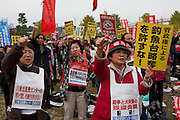 Activists punch the air at an Anti APEC (Asia Pacific Economic Conference)  Demo by left-wing activist groups and trade unions in Yokohama, Japan Sunday, November 14th 2010