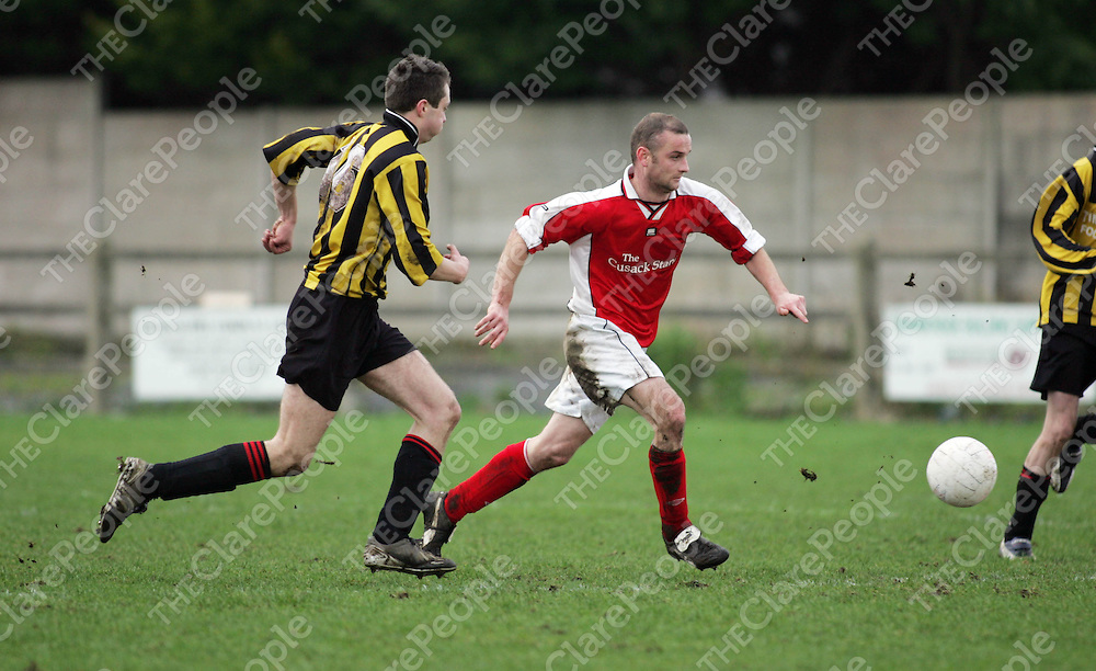 Newmarket's Mike O'Malley in posession from Bridge United's defence in thier meeting in Doora on Sunday. Pic. Brian Arthur/ Press 22.