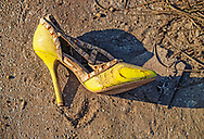 A lone shoe lies still on the ground outside homes destroyed by the wind and storm surge caused by Hurricane Dorian in an area called 'The Mudd' on Thursday, September 5, 2019 at Marsh Harbour in Great Abaco Island, Bahamas