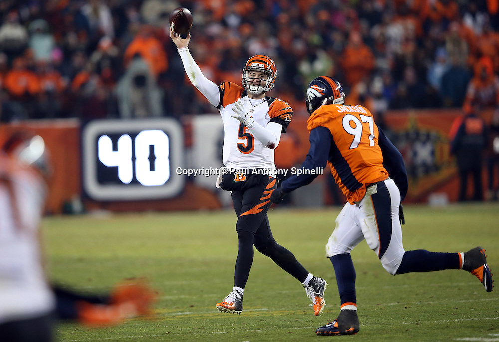 Cincinnati Bengals quarterback AJ McCarron (5) is chased by Denver Broncos defensive end Malik Jackson (97) as he throws a fourth quarter deep pass during the 2015 NFL week 16 regular season football game against the Denver Broncos on Monday, Dec. 28, 2015 in Denver. The Broncos won the game in overtime 20-17. (©Paul Anthony Spinelli)