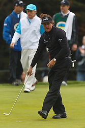 Feb 11, 2012; Pebble Beach CA, USA; Phil Mickelson after putting for birdie on the third hole during the third round of the AT&T Pebble Beach Pro-Am at Pebble Beach Golf Links. Mandatory Credit: Jason O. Watson-US PRESSWIRE