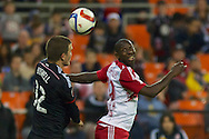 Bobby Boswell and NY's Bradley Wright-Phillips battle for the ball. Red Bull NY rallied back to tie DC United 2-2 at RFK Stadium in Washington D.C. on Saturday April 11, 2015.