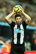 Federico Fernandez (#18) of Newcastle United takes a throw in during the Premier League match between Newcastle United and Chelsea at St. James's Park, Newcastle, England on 18 January 2020.