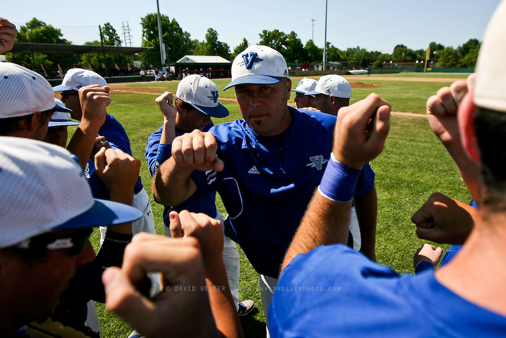 Head Coach Judd Naeger of the Valle Catholic Warriors meets with his team prior to a game against the Summit Christian Academy Eagles in the 2012 Missouri High School State Baseball Tournament at Meador Park on May 30, 2012 in Springfield, Missouri. (David Welker/TurfImages.com).