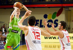 Miha Lapornik of Slovenia vs Onur Calban of Turkey and Ahmet Tuncer of Turkey during basketball match between National teams of Turkey and Slovenia in Qualifying Round of U20 Men European Championship Slovenia 2012, on July 17, 2012 in Domzale, Slovenia. (Photo by Vid Ponikvar / Sportida.com)