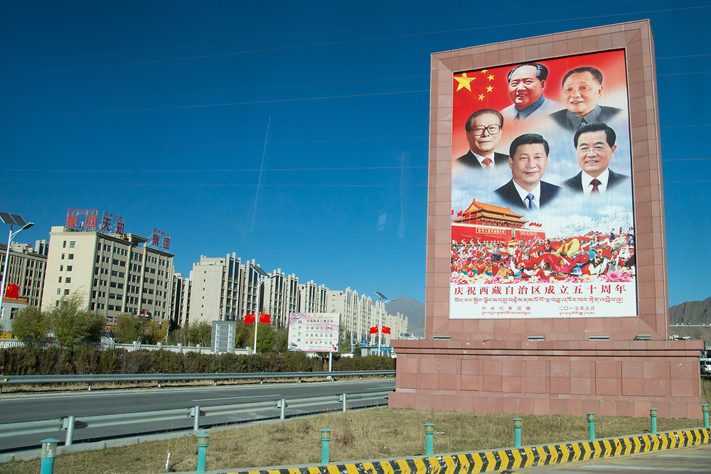Sign upon entering Tibet featuring the presidents of the People's Republic of China.  The men on the sign are Mao Zedong, Deng Xiaoping, Jiang Zemin, Hu Jintao and Xi Jinping.