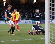 16th December 2017, Dens Park, Dundee, Scotland; Scottish Premier League football, Dundee versus Partick Thistle; Dundee's Sofien Moussa lisses the turf after scoring a penalty for 1-0