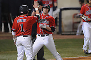 Ole Miss' Matt Tracy (29) is congratulated by Ole Miss' Preston Overbey(1) after scoring at Oxford-University Stadium in Oxford, Miss. on Wednesday, March 2, 2010.