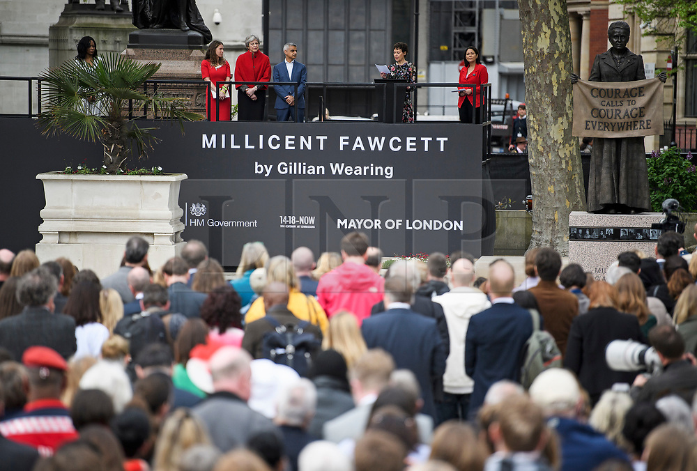 © Licensed to London News Pictures. 24/04/2018. London, UK. Campaigner Caroline Criado-Perez, British Prime Minister Theresa May and Mayor of London Sadiq Khan attend the unveiling of a statue of Millicent Fawcett in Parliament Square, London. Dame Millicent, a leading Suffragist and campaigner for equal rights for women, is the first woman to be commemorated with a statue in Parliament Square. Photo credit: Ben Cawthra/LNP