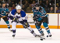 January 6, 2010; San Jose, CA, USA; San Jose Sharks defenseman Marc-Edouard Vlasic (44) takes the puck from St. Louis Blues left wing Brad Winchester (15) during the first period at HP Pavilion. San Jose defeated St. Louis 2-1 in overtime. Mandatory Credit: Jason O. Watson / US PRESSWIRE