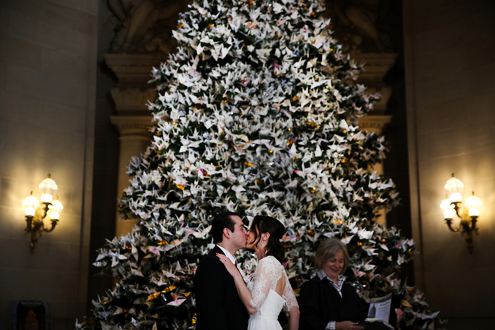 From left: Ruben Aguirre and Addyson Bailey kiss after getting married at City Hall on Tuesday, Dec. 12, 2017, in San Francisco, Calif.
