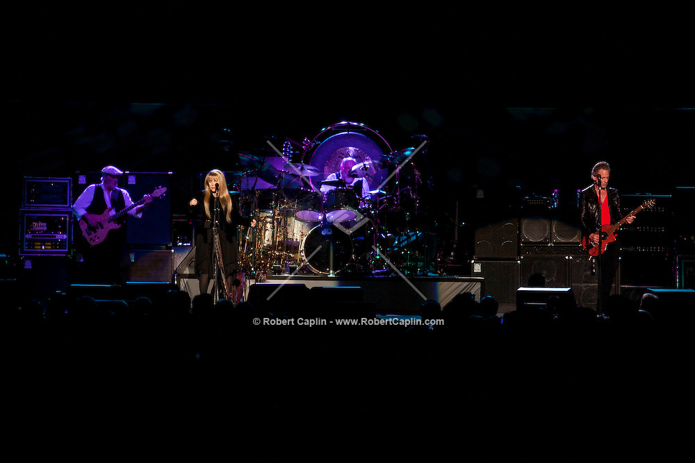 Stevie Nicks, center, Mick Fleetwood, right, and John McVie, left, of Fleetwood Mac preform at Madison Square Garden in New York, NY on Thursday, March 19, 2009. ..Robert Caplin For The New York Times