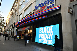 © Licensed to London News Pictures. 24/11/2017. London, UK.  Oxford Street in London almost empty shortly after 8am on the Morning of Black Friday sales. Many shops open early in the morning of Black Friday to offer offer promotional sales on items ahead of the Christmas period. Promotions have been scaled down in recent years after violence broke out at some shops between customers fighting for discounted items. Photo credit: Ben Cawthra/LNP