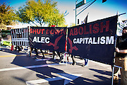 30 NOVEMBER 2011 - PHOENIX, AZ:   Anti-ALEC protesters move barricades into position at the entrance to the Westin Kierland Resort and Spa in Phoenix Wednesday. About 300 people picketed the American Legislative Exchange Council (ALEC) conference at the Westin Kierland Resort and Spa in Phoenix, AZ, Wednesday. The protesters claim ALEC, a conservative think tank, violates its tax exempt status by engaging in lobbying, a charge ALEC officials deny. Many conservative pieces of legislation, like Arizona's anti-immigration bill SB1070, originate with ALEC conferences (SB 1070 originated at an ALEC conference several years ago). Many of the protesters are also members of the Occupy movement.    PHOTO BY JACK KURTZ