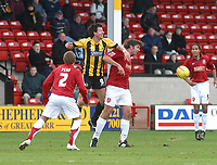 Photo: Dave Linney.<br />Walsall v Boston United. Coca Cola League 2. 27/01/2007.<br />Boston's Drewe Broughton(L)  challenges   Ian Roper for the ball.