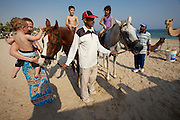 Sealine Beach Resort. Camel and horse riding.
