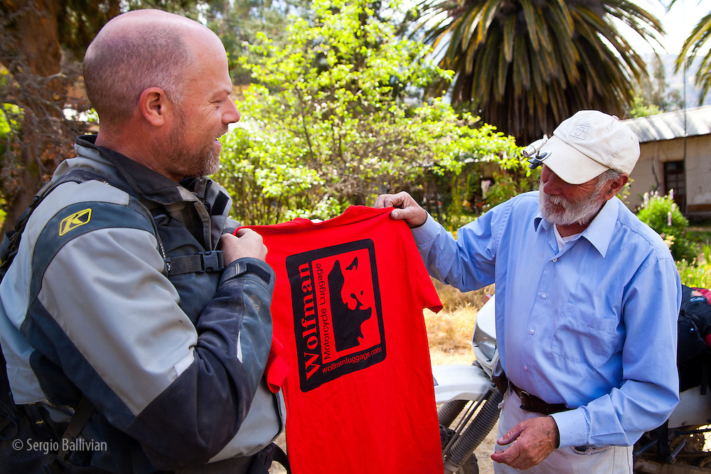 Eric Hougen presents Hans Hesse with a Wolfman t-shirt at  Hacienda Teneria in the Cordillera Quimsa Cruz, Bolivia.