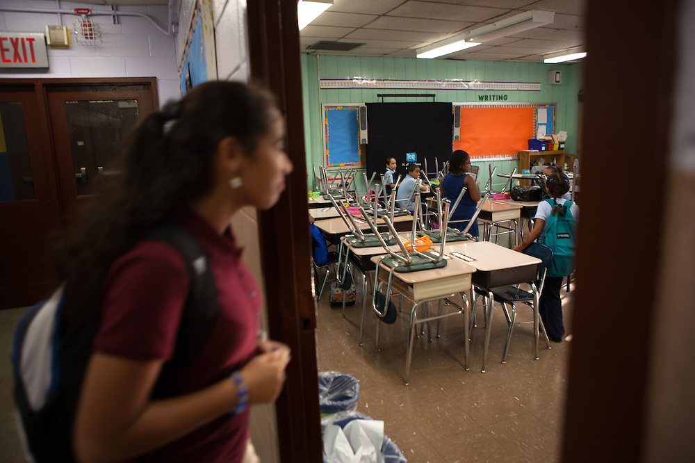 Victoria Haghighi, 12, outside her brother's 2nd-Grade classroom at PS85 in Fordham Heights, The Bronx, NY on September 11, 2013.
