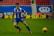 Wigan Reece James (26)  during the EFL Sky Bet League 1 match between Wigan Athletic and Fleetwood Town at the DW Stadium, Wigan, England on 9 December 2017. Photo by Michał Karpiczenko.