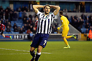 Millwall striker Lee Gregory (9) with head in hands after a miss during the EFL Sky Bet League 1 match between Millwall and Shrewsbury Town at The Den, London, England on 10 December 2016. Photo by Matthew Redman.