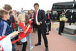 CARDIFF, WALES - Saturday, June 4, 2016: Wales' manager Chris Coleman and his team sign autographs for Ysgoal Treganna students as the team are given a colourful send off at Cardiff Airport as the squad head to Sweden for their last friendly before the UEFA Euro 2016 in France. (Pic by David Rawcliffe/Propaganda)