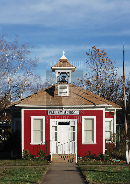 little red school house with bell tower
