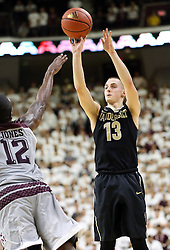 Vanderbilt's Riley LaChance (13) makes a 3-point basket as Texas A&M's Jalen Jones (12) defends during the second half of an NCAA college basketball game, Saturday, March 5, 2016, in College Station, Texas. Texas A&M won 76-67. (AP Photo/Sam Craft)