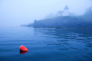 0902-1011 - Copyright: George H.H. Huey - Curtis Island lighthouse with lobster pot buoy, Camden, Maine.