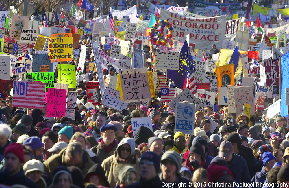 Peace rally activists march down the streets of Washington D.C. Saturday January 19th in 2003 protesting a war with Iraq.