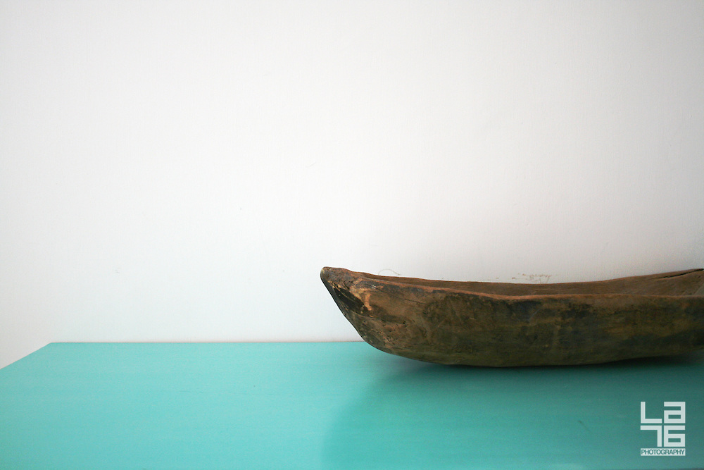 Wooden bowl and a turquoise table.<br />