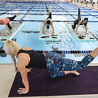 Adam Robison | BUY AT PHOTOS.DJOURNAL.COM<br /> Kristi Paxton, yoga instructor for Bogafit, leads her class in an exercise at the Tupelo Aquatic Center on Monday morning. Bogafit is yoga on-mats-in-the-pool exercise program and is controlled instability to help build better core strength.