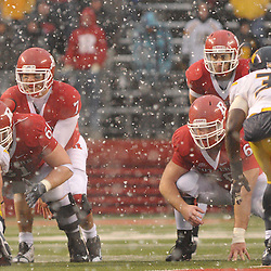 Dec 5, 2009; Piscataway, NJ, USA; Rutgers quarterback Tom Savage (7) sets up under center in increasing amounts of snow during second half NCAA Big East college football action in West Virginia's 24-21 victory over Rutgers at Rutgers Stadium.