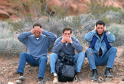 "Thre men outdoors acting out the phrase""See No Evil, Hear No Evil, Speak No Evil"""