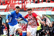 Rangers defender Connor Goldson (6) and Hamilton Accademical forward George Oakley (9) battle for possession during the Ladbrokes Scottish Premiership match between Hamilton Academical FC and Rangers at New Douglas Park, Hamilton, Scotland on 24 February 2019.