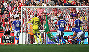 Bartosz Bialkowski saving just before conceding during the Sky Bet Championship match between Brentford and Ipswich Town at Griffin Park, London, England on 8 August 2015. Photo by Matthew Redman.