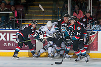 KELOWNA, CANADA - OCTOBER 26: Ryan Peckford #10 of the Victoria Royals gets tangled up with Nick Merkley #10 and Calvin Thurkauf #27 as Jake Kryski #14 of the Kelowna Rockets passes the puck during first period on October 26, 2016 at Prospera Place in Kelowna, British Columbia, Canada.  (Photo by Marissa Baecker/Shoot the Breeze)  *** Local Caption ***