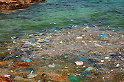 Cyprus, Agia Napa waste, garbage and dirt floating in the Mediterranean Sea near the shore
