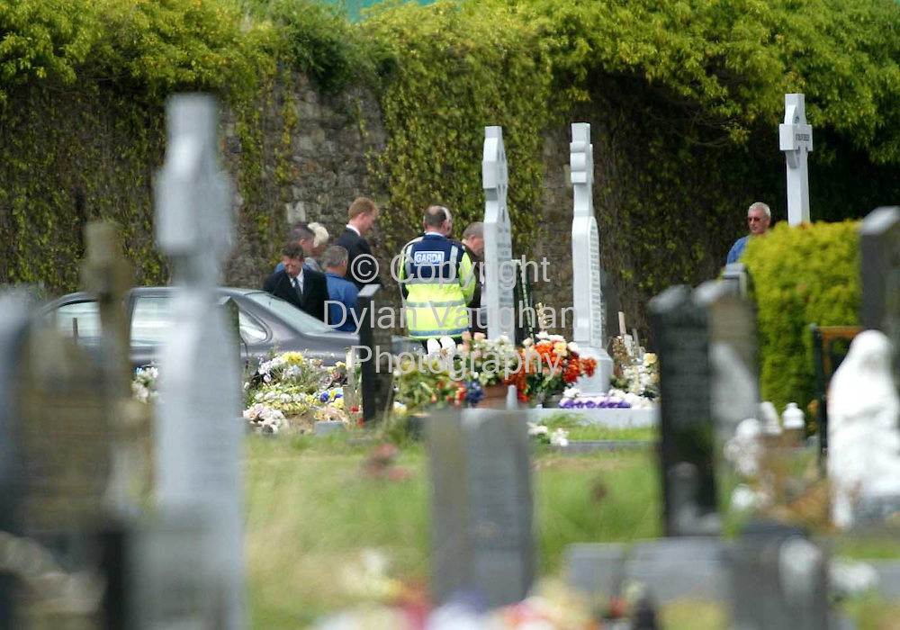 21/8/2003.Mourners attending the burial of Callis Osaghae at St Otterans cemetary on the cork road in Waterford yesterday..Picture Dylan Vaughan
