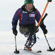 Peter Dunning, Great Britain, before his third place finish in the Men's Slalom Sitting, Adaptive Slalom competition at Coronet Peak, New Zealand during the Winter Games. Dunning, who lost both his legs in a roadside bombing attack in Afghanistan three years ago. Winter Games, Queenstown, New Zealand, 25th August 2011. Photo Tim Clayton