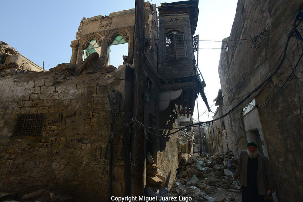 Aleppo, Syria, January 2013 -Ancient houses--some more than 1,000 years old--are being bombed regularly by the Syrian Army across the Old City area of Aleppo. Imam AHMED TIF checks the damage. (Photo by Miguel Juárez Lugo)