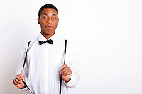 Portrait of young man wearing suspenders over white background
