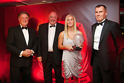 CARDIFF, WALES - Monday, October 6, 2014: Wales' Kylie Davies picks up the Women's Player of the Year Award on behalf of Jessica Fishlock from Vauxhall's Dennis Chick (L), FAW President Trefor Lloyd-Hughes (C) and Wales women's manager Jarmo Matikainen at the FAW Footballer of the Year Awards 2014 held at the St. David's Hotel. (Pic by David Rawcliffe/Propaganda)