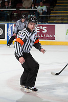 KELOWNA, CANADA - MARCH 23: Ryan Benbow, referee skates on the ice at the Kelowna Rockets against the Tri-City Americans on March 23, 2014 at Prospera Place in Kelowna, British Columbia, Canada.   (Photo by Marissa Baecker/Shoot the Breeze)  *** Local Caption *** Ryan Benbow;