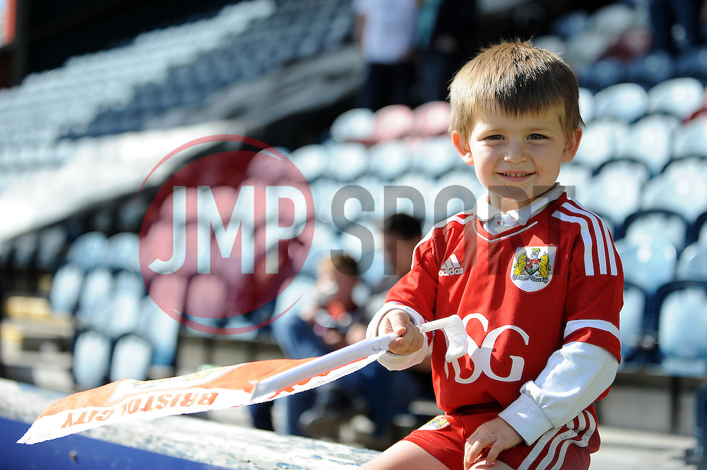 A young Bristol City fan at Rochdale AFC, Spotland Stadium - Photo mandatory by-line: Dougie Allward/JMP - Mobile: 07966 386802 23/08/2014 - SPORT - FOOTBALL - Manchester - Spotland Stadium - Rochdale AFC v Bristol City - Sky Bet League One